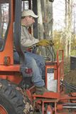 Man Operating Backhoe Stock Photography