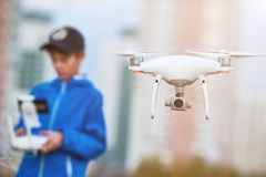 Young man operating of flying drone at sunset Royalty Free Stock Images