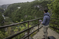 Man is operating drone with a Plitvice waterfalls background Stock Photo
