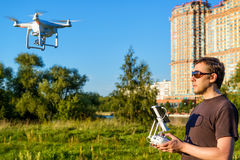 Man operating drone quad copter in city park Royalty Free Stock Images