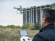 Man operating a drone quad copter with onboard digital camera.  Royalty Free Stock Photo