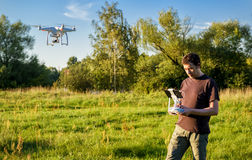 Man operating a drone quad copter in the park Royalty Free Stock Photos