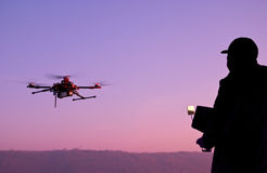 Man operating a drone with remote control. Dark silhouette again Royalty Free Stock Photo