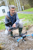 Man operating a drone with remote control outdoors royalty free stock image