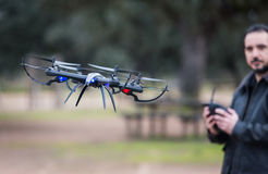 A man Operating The Drone By Remote Control In The Park royalty free stock photography