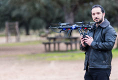 A man Operating The Drone By Remote Control In The Park royalty free stock image