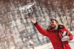 Man operating drone with remote control radio controlled device. Modern technology details stock images