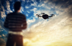 Man operating a drone at sunset. Royalty Free Stock Image