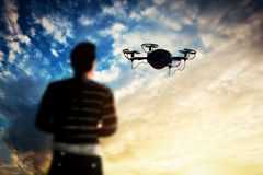 Man operating a drone at sunset. Royalty Free Stock Photo