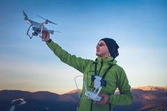 Man operating a drone Stock Photos