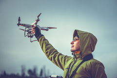 Man operating a drone Stock Image