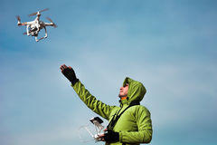 Man operating a drone Stock Photos