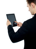 Man operating electronic digital device Stock Image