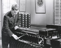 Man operating fingerprint sorting machine Stock Photo