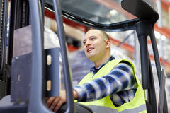Man operating forklift loader at warehouse Royalty Free Stock Image