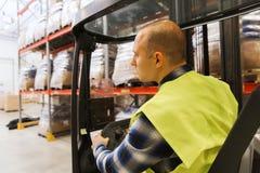 Man operating forklift loader at warehouse Royalty Free Stock Photos