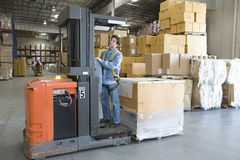 Man Operating Forklift Truck In Warehouse Stock Images