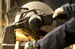 Man operating grinder Royalty Free Stock Images