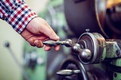 Man operating lathe grinding machine royalty free stock image