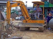 Man is operating power shovel in Bangkok, Thailand. Bangkok, Thailand - May 11, 2015: man is operating power shovel in Bangkok, Thailand Royalty Free Stock Photography