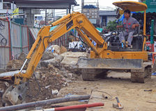 Man is operating power shovel in Bangkok, Thailand Royalty Free Stock Images