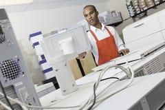 Man operating printing machine at press Stock Photos