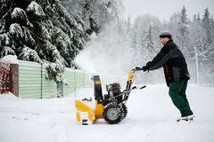 A man operating snow blower Royalty Free Stock Image