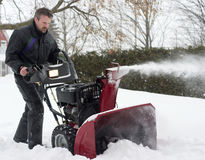 Man operating snow blower. In winter Royalty Free Stock Photo