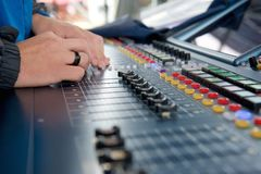 Man operating studio audio mixer royalty free stock images