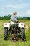 Man operating a tractor stock image