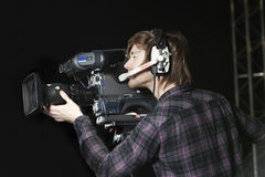 Man operating a TV Studio Camera Stock Photography