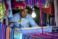 A man operating a weaving loom in the Nubian village of Garb-Sohel in the Aswan region of Egypt. Stock Photo