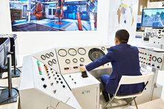 Man operator with joystick control of oil drilling equipment. Man operator with joystick control of production oil equipment stock images