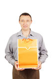 Man with orange bag for shopping Stock Photos