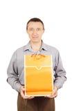 Man with orange bag for shopping Stock Photos