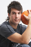 Man with orange ball Royalty Free Stock Photography