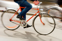 Man on orange bike Stock Photo