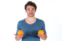 Man with orange Stock Photography