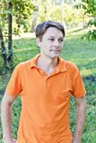 Man in orange clothes Stock Photography