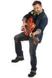 Man with orange electric guitar and yellow rose Royalty Free Stock Images