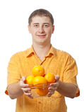 Man with orange fruits in hands Stock Image