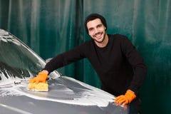 A foamy process of washing a car stock image