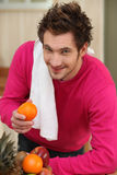 Man with an orange. Man with orange in hand Royalty Free Stock Photography
