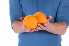Man and orange Royalty Free Stock Photos