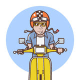 Man with orange helmet riding a yellow scooter Stock Photo