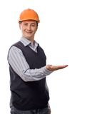 Man in orange helmet showing empty palm Royalty Free Stock Photo