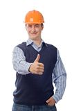 Man in orange helmet showing good sign Royalty Free Stock Photography