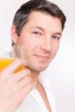 Man orange juice Royalty Free Stock Photo