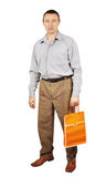 Man with orange paper package for shopping Stock Image