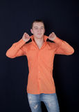 The man in an orange shirt Royalty Free Stock Photos